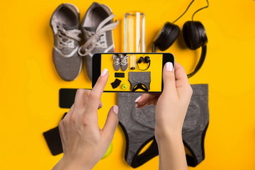 Sport equipment photographing on mobile phone. Smartphone screen with fitness tools image