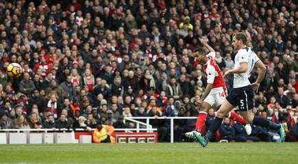 Arsenal's Theo Walcott has a shot at goal