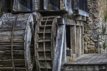 at the Falls is an old watermill by large wheel