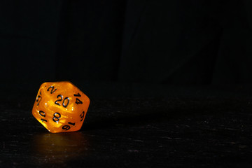 A polyhedral twenty sided die used for role playing games such as Dungeons & Dragons.