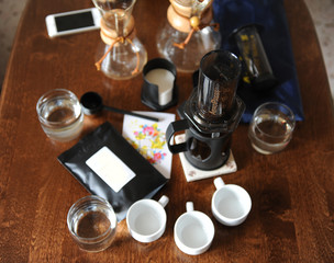 Coffee accessories on a dark wooden table