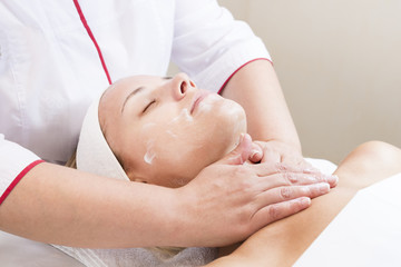 Process cosmetic mask of massage and facials in beauty salon