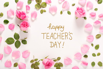 Teacher's Day message with roses and leaves top view flat lay