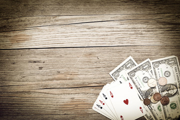 ace poker and cash on wooden background