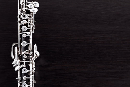 Musical background, poster - oboe on black background .  Free space for text.