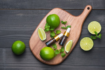Natural cosmetics for home spa. Bottle of essence oil with fresh limes