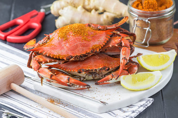 Maryland blue crabs with seafood utensils