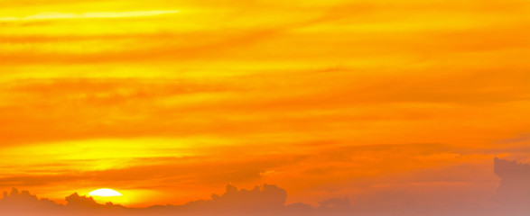Orange sky with clouds at dusk