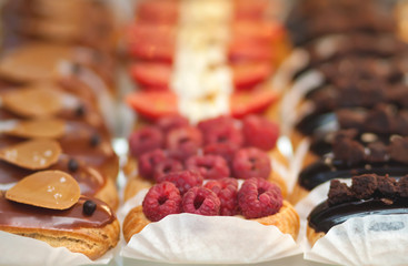 Delicious appetizing brewed cakes. Sweet glazed pastries close-up.