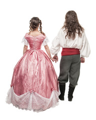 Beautiful couple woman and man in medieval clothes. Back pose