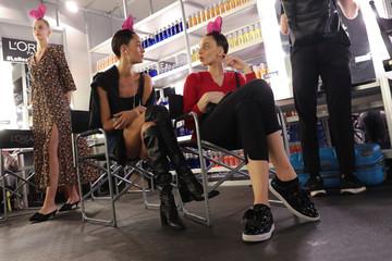 Models converse at makeup booth before presenting creations from Agatha  Ruiz de la Prada s Spring  8510e6e73