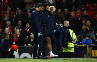 Tottenham's Mousa Dembele is helped down the tunnel after the game