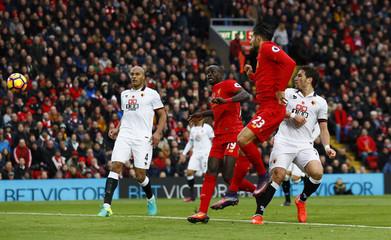 Liverpool's Emre Can scores their third goal