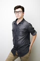 Stylish handsome young man posing. Studio shot on white background