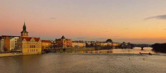 Prague sunset view from Charles Bridge over Vltava River