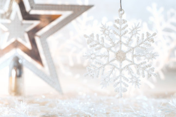 Christmas golden star and snowflake on a beautiful background. Christmas background.