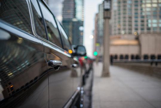 Passenger door handle of a black SUV
