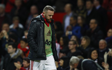 Manchester United's Wayne Rooney walks off after the game