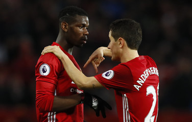 Manchester United's Paul Pogba speaks with Ander Herrera