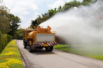Officials are spraying water from the atomizer, On large water truck outdoor
