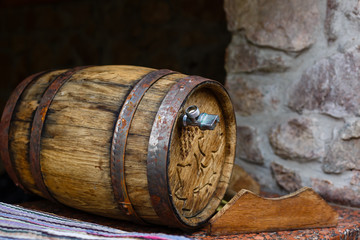 a barrel of wine in a wine cellar