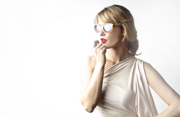 Fashionable woman wearing glasses and red lipstick