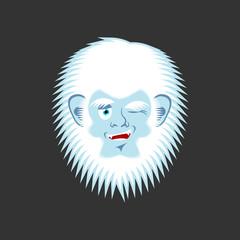 Yeti winks emoji. Abominable snowman cheerful avatar. Bigfoot joyful emotion face. Vector illustration