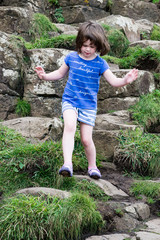 Young Girl walking on the rocks at Giant's Causeway