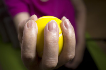 Senior woman doing exercises with a ball in her hands