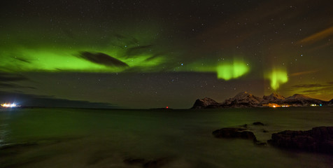 Aurora borealis (Polar lights) over the mountains in the North of Europe - Lofoten Islands, Norway