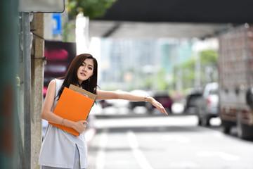 Asian Business woman hailing cab.
