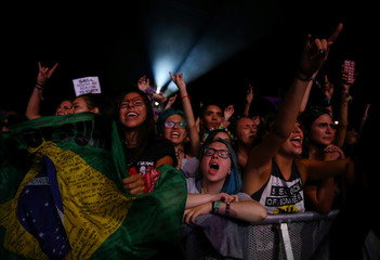 Rock fans cheer during a concert at the Rock in Rio Music Festival in Rio de Janeiro