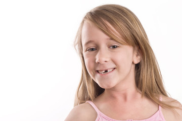 young girl showing off her missing front tooth