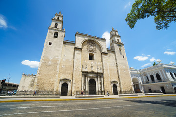 CANCUN, MEXICO - MAY 23, 2017: Front side of central Cathedral with big wooden gate doors and walls of stone