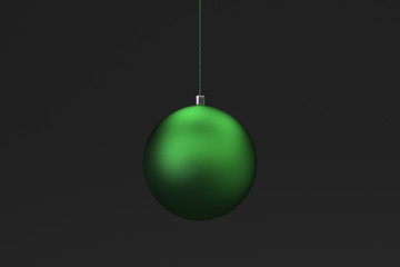 Green christmas balls on black background