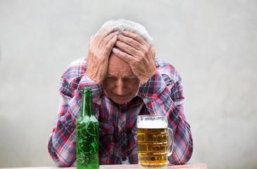 Senior drunk man with hangover