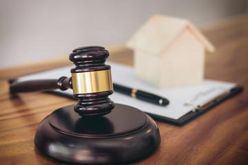 Gavel on sounding block at courtroom for decide home insurance, Law and justice concept, Settle a house dealing lawsuit