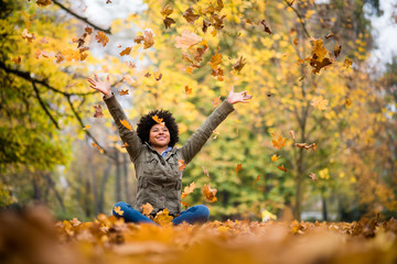 Teenage girl having fun during autumn season
