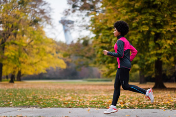 Fit mixed race model jogging outdoors