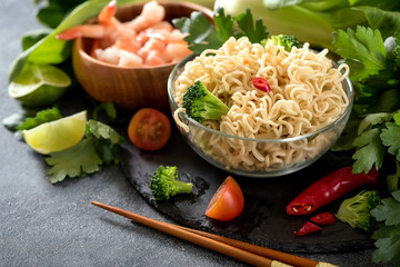 Chinese or thai noodles with vegetables, fast lunch, asian food with chopsticks