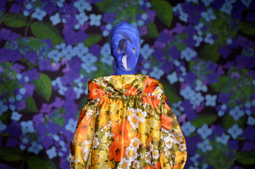 A model displays a garment in Richard Quinn's Spring/Summer 2018 show in the Liberty Store at London Fashion Week in London