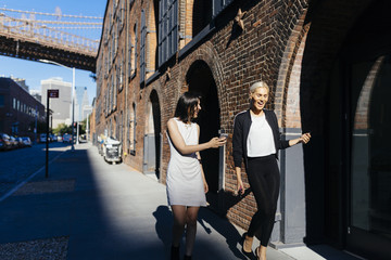 Two Businesswoman on the Streets Of New York City