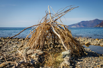 Taken on the westcoast of corsica on the beautiful beach of catarelli we build a hut of drifting wood during a great day at the beach.