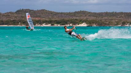 Windsurfer and kitesurfer