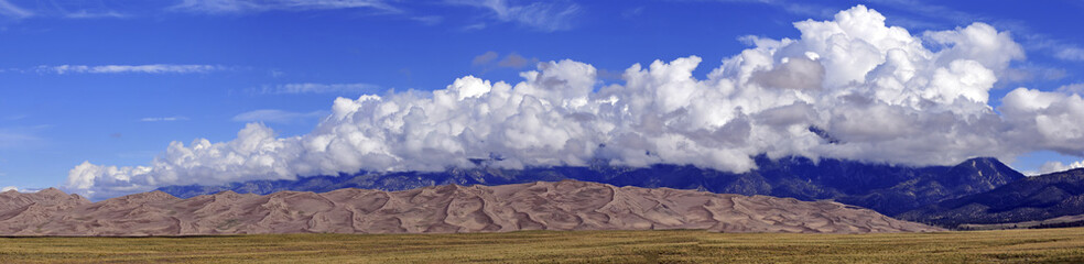 Panorama of Sand, clouds and Mountain peaks, Rocky Mountains, USA