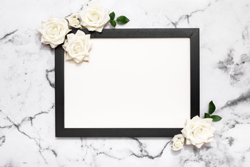 Blank picture frame on white marble table top view, Mock up for adding your photo in copy space, wedding, mother's day, celebration event