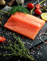 Fresh raw salmon fillet steak with aromatic herbs, spices