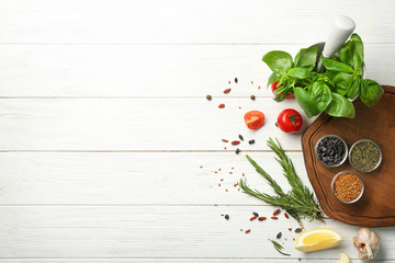 Composition with wooden board and ingredients for cooking on table