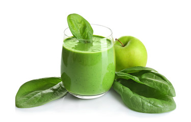 Glass of spinach smoothie isolated on white