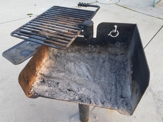 a dirty grill with handicap or wheelchair symbol